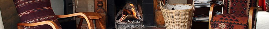 Open fire in living room at Muddy Creek Cutting B&B